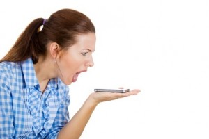 Angry, screaming woman on a cell phone